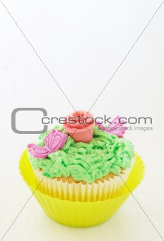 Vanilla cupcake with rose decorations