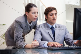 Business team looking at computer screen together