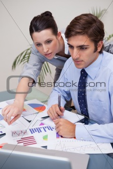 Business team working on statistics together