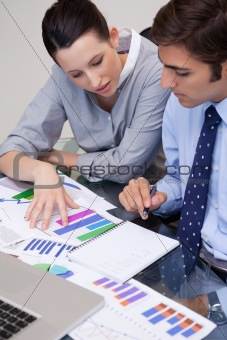 Business team analyzing charts