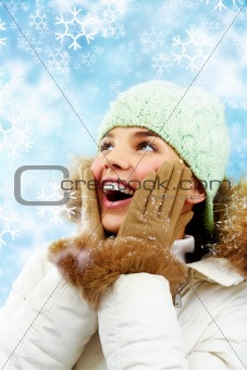 Surprised woman in winter clothes