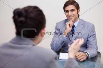 Smiling businessman in a negotiation