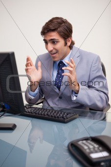 Businessman getting confused by his computer