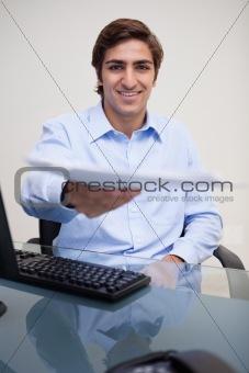 Smiling businessman handing over paperwork