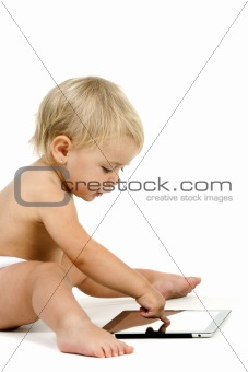 Baby girl with tablet on white background