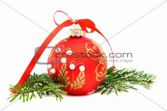 Christmas ball and a pine branch.