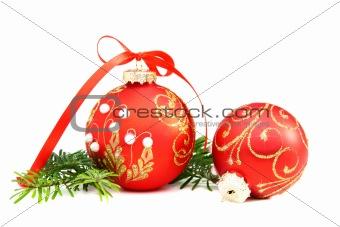 Christmas balls and a pine branch.