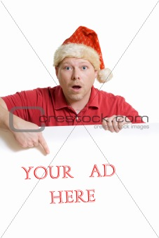 Man in Santa hat and red shirt holds a white card ad sign