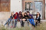 Young punk gang hanging out behind an abandoned urban building.