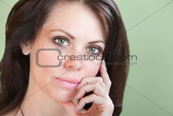 Cute Woman With Fingers On Chin