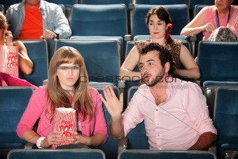 Man Talks to Woman in Theater