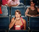 Shocked Woman Eats Popcorn