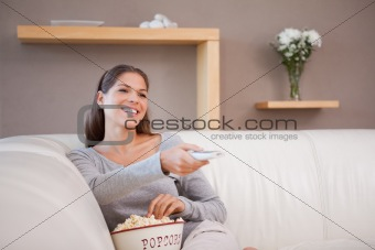 Woman watching a movie with a bowl of popcorn