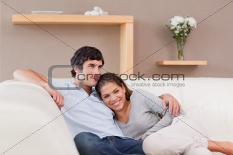 Couple being together on the sofa