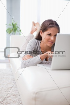 Woman on the sofa browsing the internet
