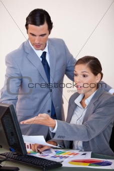 Business people analyzing statistics together