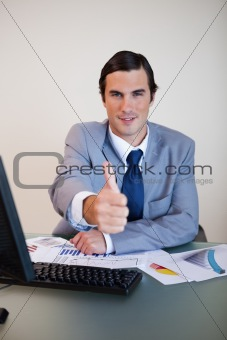 Businessman approves with thumb up