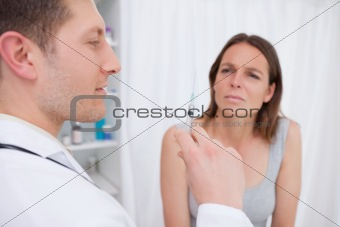 Doctor preparing injection