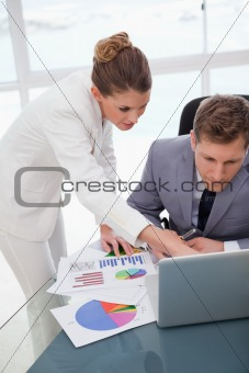 Business team working on survey results