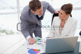 Business team analyzing poll results