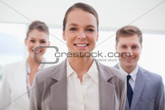 Business consultant with her team behind her