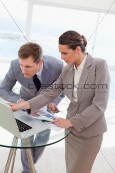 Analyst explaining report to her boss