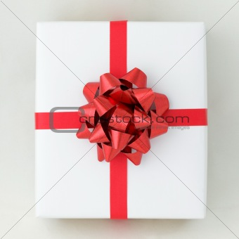 Top view of Red star and Cross line ribbon on White paper box
