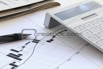 stock chart with solar power calculator and gray pen