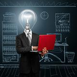lamp head businessman with laptop