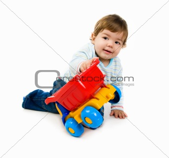 little boy  with a big car