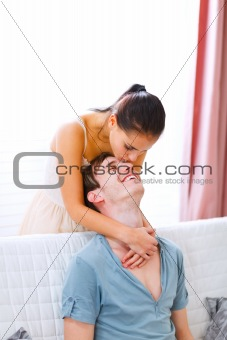 Cheerful couple in love enjoying themselves at home
