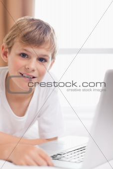 Portrait of a young boy using a laptop