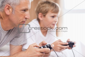 Father playing video games with his son