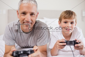Boy and his father playing video games