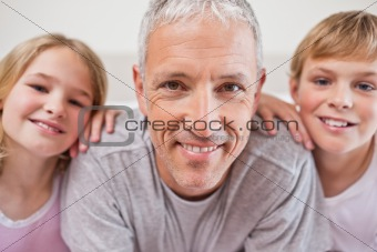 Close up of siblings and their father posing