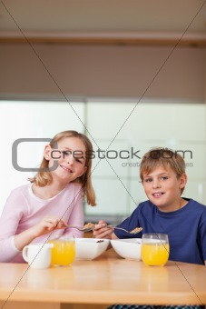 Portrait of young children having breakfast