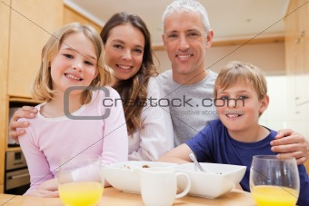 Close up of a smiling family having breakfast