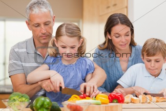 Charming family cooking together