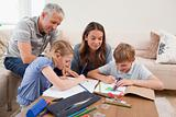 Parents helping their children to do their homework