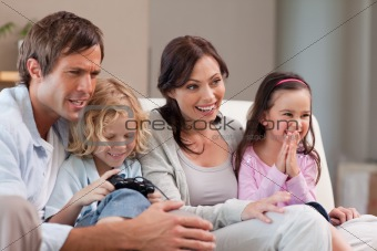 Happy family playing video games together