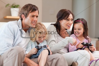 Competitive family playing video games together