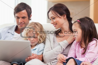 Serene family using a notebook