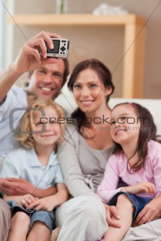 Portrait of a father taking a picture of his family