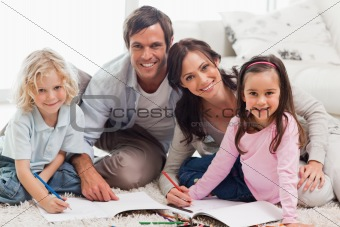 Charming family drawing together