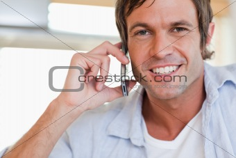 Close up of a man making a phone call