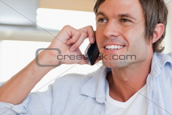 Close up of a smiling man making a phone call