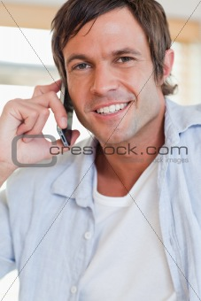 Portrait of an attractive man making a phone call