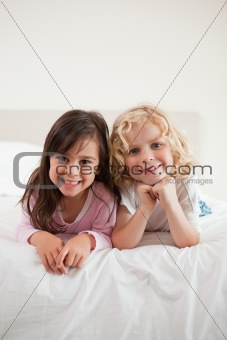 Portrait of children lying on their bellies