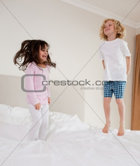 Portrait of children jumping