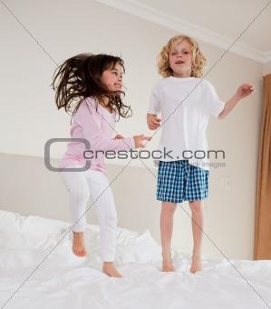 Portrait of siblings jumping